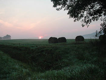 Sunrise over hay bales at Henry Hill Farm